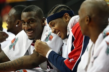 LAS VEGAS - SEPTEMBER 1:  Amare Stoudemire #12 and Carmelo Anthony #15 of the USA laugh as they watch from the bench during the FIBA Americas Championship 2007 Semifinal game at the Thomas & Mack Center September 1, 2007 in Las Vegas, Nevada.  (Photo by J