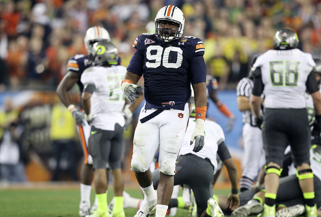 GLENDALE, AZ - JANUARY 10:  Nick Fairley #90 of the Auburn Tigers reacts during their Tostitos BCS National Championship Game against the Oregon Ducks at University of Phoenix Stadium on January 10, 2011 in Glendale, Arizona.  (Photo by Christian Petersen
