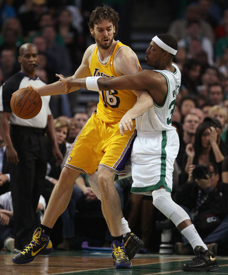 BOSTON, MA - FEBRUARY 10:  Pau Gasol #16 of the Los Angeles Lakers tries to get around Paul Pierce #34 of the Boston Celtics on February 10, 2011 at the TD Garden in Boston, Massachusetts.  NOTE TO USER: User expressly acknowledges and agrees that, by dow