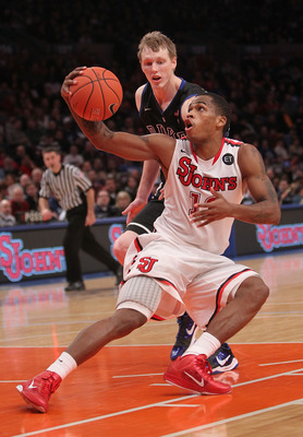 NEW YORK, NY - JANUARY 30: Dwight Hardy #12 of the St. John's Red Storm fakes in front of Kyle Singler #12 of the Duke Blue Devils  at Madison Square Garden on January 30, 2011 in New York City.  (Photo by Nick Laham/Getty Images)