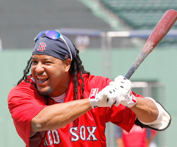 BOSTON - JULY 26:  Manny Ramirez #24 of the Boston Red Sox laughs during batting practice before a game with the New York Yankees at Fenway Park on July 26, 2008 in Boston, Massachusetts.  (Photo by Jim Rogash/Getty Images)