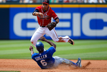 ATLANTA - JUNE 20:  Jose Guillen #6 of the Kansas City Royals slides into Martin Prado #14 of the Atlanta Braves at second base to break up a double play at Turner Field on June 20, 2010 in Atlanta, Georgia.  (Photo by Kevin C. Cox/Getty Images)