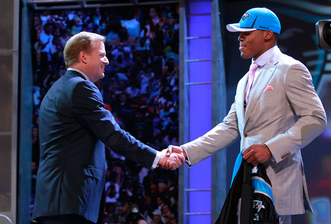NEW YORK, NY - APRIL 28:  NFL Commissioner Roger Goodell greets Carolina Panthers #1 overall pick Cam Newton from the Auburn during the 2011 NFL Draft at Radio City Music Hall on April 28, 2011 in New York City.  (Photo by Chris Trotman/Getty Images)