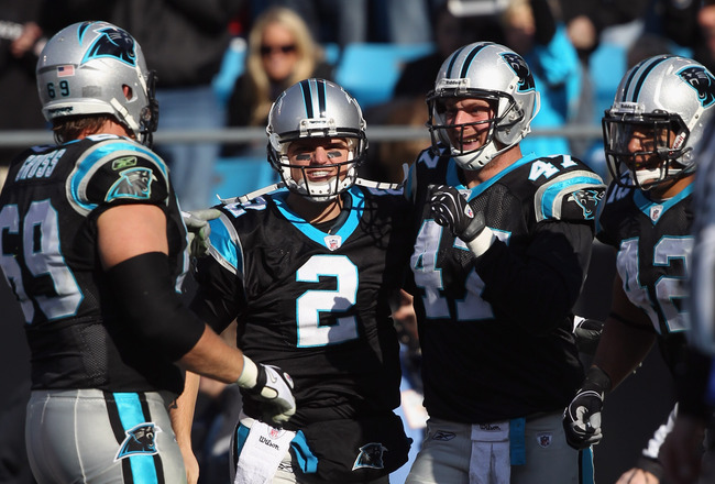 CHARLOTTE, NC - DECEMBER 19:  Teammates Jimmy Clausen #2 and Jeff King #47 of the Carolina Panthers celebrate after a touchdown by King during their game against the Arizona Cardinals at Bank of America Stadium on December 19, 2010 in Charlotte, North Car