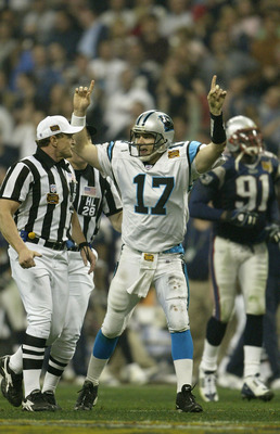 HOUSTON, TX - FEBRUARY 1:  Quarterback Jake Delhomme #17 of the Carolina Panthers celebrates his 85 yard touchdown pass to Muhsin Muhammad #87 against the New England Patriots during the fourth quarter of Super Bowl XXXVIII at Reliant Stadium on February