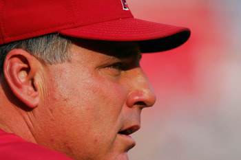 ARLINGTON, TX - JULY 21:  Manager Mike Scioscia of the Anaheim Angels watches play against the Texas Rangers on July 21, 2004 at Ameriquest Field in Arlington in Arlington, Texas. (Photo by Ronald Martinez/Getty Images)