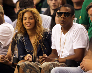 BOSTON - MAY 07:  Singers Beyonce and Jay-Z sit courtside during a game between the Cleveland Cavaliers and the Boston Celtics during Game Three of the Eastern Conference Semifinals during the 2010 NBA Playoffs at TD Banknorth Garden on May 7, 2010 in Bos