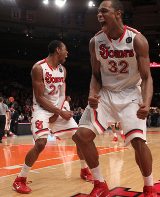 NEW YORK, NY - JANUARY 30: Paris Horne #23 of the St. John's Red Storm celebrates the win with teammate Justin Brownlee #32 against the Duke Blue Devils  at Madison Square Garden on January 30, 2011 in New York City.  (Photo by Nick Laham/Getty Images)