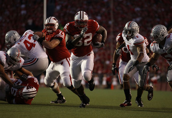 MADISON, WI - OCTOBER 16: John Clay #32 of the Wisconsin Badgers runs for a touchdown against the Ohio State Buckeyes at Camp Randall Stadium on October 16, 2010 in Madison, Wisconsin. Wisconsin defeated Ohio State 31-18. (Photo by Jonathan Daniel/Getty I