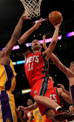 LOS ANGELES, CA - JANUARY 14:  Brook Lopez #11 of the New Jersey Netsgoes up for a shot against the Los Angeles Lakers at Staples Center on January 14, 2011 in Los Angeles, California.  NOTE TO USER: User expressly acknowledges and agrees that, by downloa