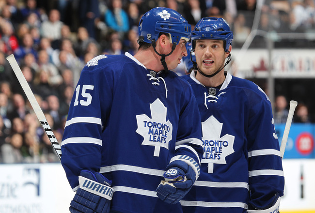 TORONTO, CAN - FEBRUARY 7:  Tim Brent #37 and Tomas Kaberle #15 of the Toronto Maple Leafs chat prior to a faceoff in a game against the Atlanta Thrashers on February 7, 2011 at the Air Canada Centre in Toronto, Canada. The Leafs defeated the Thrashers 5-