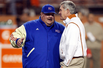 AUSTIN, TX - NOVEMBER 21:  Head coach Mark Mangino of the Kansas Jayhawks talks with Mack Brown of the Texas Longhorns at Darrell K Royal-Texas Memorial Stadium on November 21, 2009 in Austin, Texas.  (Photo by Ronald Martinez/Getty Images)