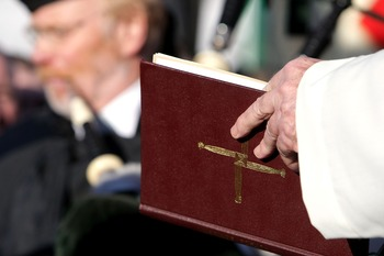 MUNICH, GERMANY - FEBRUARY 05:  A priest reads out of bible during the 50th anniversary to commerate the Munich air disaster on February 6, 2008 in Kirchtrudering , Germany. 23 people died in an airplane crash at Munich Airport 50 years ago. Eight Manches