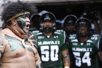 HONOLULU - SEPTEMBER 02: Vili Fehoko, the University of Hawaii Mascot cheers as the University of Hawaii Warriors prepare to take the field in their season opener at Aloha Stadium September 2, 2010 in Honolulu, Hawaii. (Photo by Kent Nishimura/Getty Image