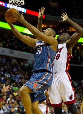 CHARLOTTE, NC - FEBRUARY 04:  Boris Diaw #32 of the Charlotte Bobcats drives to the basket past Joel Anthony #50 of the Miami Heat at the Time Warner Cable Arena on February 4, 2011 in Charlotte, North Carolina.  The Heat defeated the Bobcats 109-97.  NOT