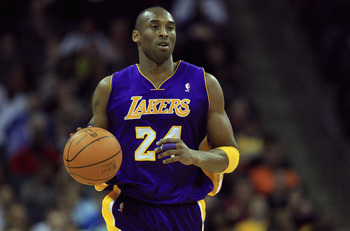 CHARLOTTE, NC - FEBRUARY 14:  Kobe Bryant #24 of the Los Angeles Lakers dribbles the ball up the court against the Charlotte Bobcats during their game at Time Warner Cable Arena on February 14, 2011 in Charlotte, North Carolina. NOTE TO USER: User express