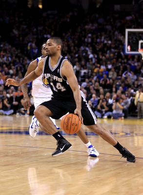 OAKLAND, CA - JANUARY 24:  Gary Neal #14 of the San Antonio Spurs in action against the Golden State Warriors at Oracle Arena on January 24, 2011 in Oakland, California.  NOTE TO USER: User expressly acknowledges and agrees that, by downloading and or usi