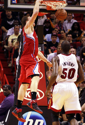 MIAMI - FEBRUARY 06:  Forward Blake Griffin #32 of the  L.A. Clippers dunks against the Miami Heat at American Airlines Arena on February 6, 2011 in Miami, Florida. NOTE TO USER: User expressly acknowledges and agrees that, by downloading and or using thi