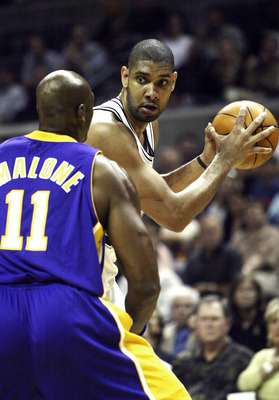 SAN ANTONIO - MAY 2:  Tim Duncan #21 of the San Antonio Spurs tries to create a play defended by Karl Malone #11 of the Los Angeles Lakers during Game one of the Western Conference Semifinals during the 2004 NBA Playoffs on May 2, 2004 at the SBC Center i