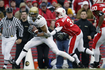 LINCOLN, NE - NOVEMBER 29:  Wide receiver Derek McCoy #80 of the University of Colorado Buffaloes pulls down a 40-yard touchdown pass against cornerback Fabian Washington #3 of the University of Nebraska Cornhuskers in the first quarter of the NCAA game a