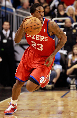 ORLANDO, FL - DECEMBER 18:  Louis Williams #23 of the Philadelphia 76ers brings the ball up the court during the game against the Orlando Magic at Amway Arena on December 18, 2010 in Orlando, Florida.  NOTE TO USER: User expressly acknowledges and agrees