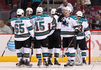 GLENDALE, AZ - JANUARY 17:  Joe Thornton #19 of the San Jose Sharks celebrates with teammates after the NHL game against the Phoenix Coyotes at Jobing.com Arena on January 17, 2011 in Glendale, Arizona.  The Sharks defeated the Coyotes 4-2.  (Photo by Chr