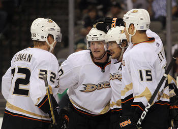DALLAS - OCTOBER 26: (L-R) Toni Lydman #32, Corey Perry #10, Teemu Selanne #8 and Ryan Getzlaf #15 of the Anaheim Ducks celebrate Selanne's third period goal against the Dallas Stars at the American Airlines Center on October 26, 2010 in Dallas, Texas. Th