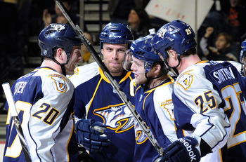 NASHVILLE, TN - JANUARY 02:  Ryan Suter #20, Shea Weber #6, and Jerred Smithson #25, congratulate teammate Nick Spaling #13 of the Nashville Predators on scoring a goal against the Columbus Blue Jackets on January 2, 2011 at the Bridgestone Arena in Nashv