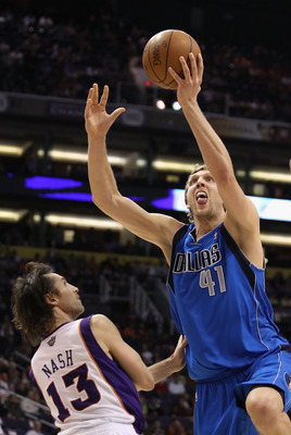 PHOENIX, AZ - FEBRUARY 17:  Dirk Nowitzki #41 of the Dallas Mavericks puts up a shot over Steve Nash #13 of the Phoenix Suns during the NBA game at US Airways Center on February 17, 2011 in Phoenix, Arizona.  The Mavericks defeated the Suns 112-106. NOTE