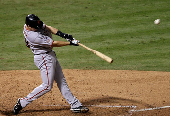 ARLINGTON, TX - NOVEMBER 01:  Buster Posey #28 of the San Francisco Giants bats against the Texas Rangers in Game Five of the 2010 MLB World Series at Rangers Ballpark in Arlington on November 1, 2010 in Arlington, Texas.  (Photo by Elsa/Getty Images)