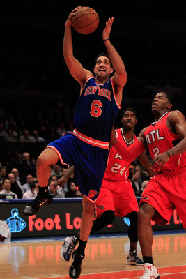 NEW YORK, NY - FEBRUARY 16: Landry Fields #6 of the New York Knicks shoots the ball over Joe Johnson #2 of the Atlanta Hawks at Madison Square Garden on February 16, 2011 in New York City. NOTE TO USER: User expressly acknowledges and agrees that, by down