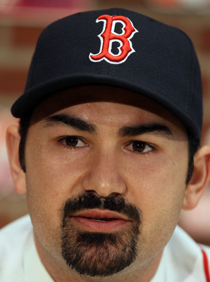 BOSTON, MA - DECEMBER 06:  Adrian Gonzalez answers questions during a press conference to announce his signing with the Boston Red Sox on December 6,  2010 at Fenway Park in Boston, Massachusetts.  (Photo by Elsa/Getty Images)