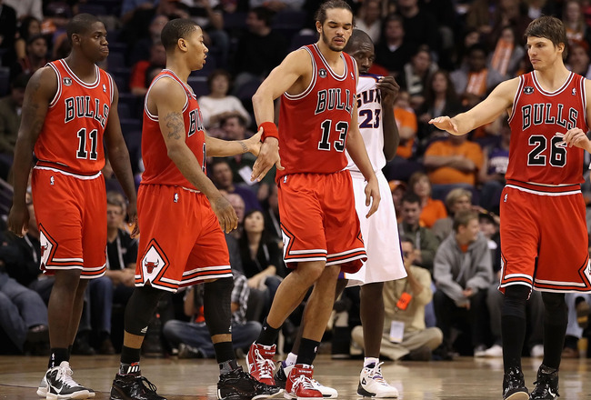 PHOENIX - NOVEMBER 24:  Derrick Rose #1 of the Chicago Bulls high fives teammate Joakim Noah #13 after scoring against the Phoenix Suns during the NBA game at US Airways Center on November 24, 2010 in Phoenix, Arizona. The Bulls defeated the Suns 123-115
