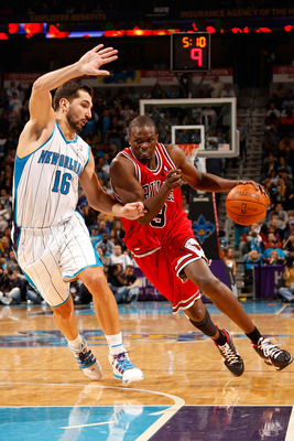 NEW ORLEANS - JANUARY 29:  Luol Deng #9 of the Chicago Bulls drives the ball around Peja Stojakovic #16 of the New Orleans Hornets at the New Orleans Arena on January 29, 2010 in New Orleans, Louisiana.   The Bulls defeated the Hornets 108-106 in overtime