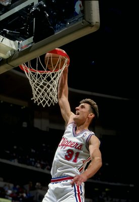 28 Nov 1997:  Guard Brent Barry of the Los Angeles Clippers in action against the New Jersey Nets during a game at Arrowhead Pond in Anaheim, California.  The Nets defeated the Clippers 104-92. Mandatory Credit: Todd Warshaw  /Allsport