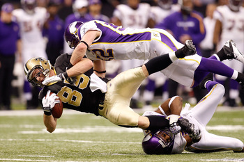NEW ORLEANS - JANUARY 24:  Jeremy Shockey #88 of the New Orleans Saints gets tackled by Chad Greenway #52 and Antoine Winfield #26 of the Minnesota Vikings after catching a pass for a first down during the NFC Championship Game at the Louisana Superdome o
