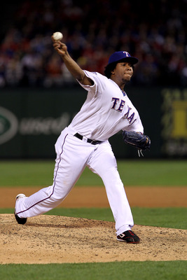 ARLINGTON, TX - NOVEMBER 01:  Neftali Feliz #30 of the Texas Rangers pitches against the San Francisco Giants in Game Five of the 2010 MLB World Series at Rangers Ballpark in Arlington on November 1, 2010 in Arlington, Texas. The Giants won 3-1.  (Photo b