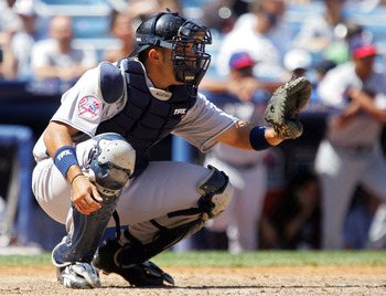 NEW YORK - JULY 13:  Jesus Montero of the New York Yankees and playing for World Futures Team catches against the United States Olympic Team during the 2008 XM All-Star Futures Game at Yankee Stadium on July 13, 2008 in the Bronx borough of New York City.