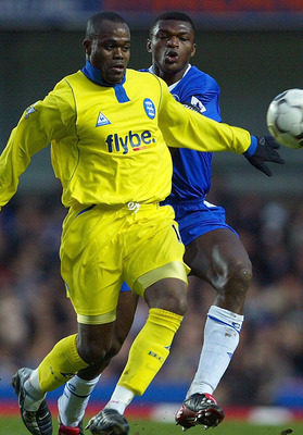 LONDON - JANUARY 18: Marcel Desailly of Chelsea tries to tackle Stern John of Birmingham City during the FA Barclaycard Premiership match between Chelsea and Birmingham City at Stamford Bridge on January 18, 2004 in London.  (Photo by Phil Cole/Getty Imag
