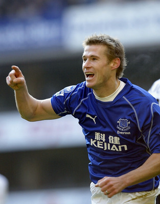 LONDON - JANUARY12:  Brian McBride of Everton celebrates scoring the first goal during the FA Barclaycard Premiership match between Tottenham Hotspur and Everton at White Hart Lane, London on January 12, 2003. (Photo by David Cannon/Getty Images)