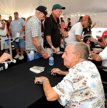 DARLINGTON, SC - SEPTEMBER 27:  NASCAR legend Rex White signs autographs during the Darlington Historic Racing Festival on September 27, 2009 at Darlington Raceway in Darlington, South Carolina.  (Photo by Rusty Jarrett/Getty Images)