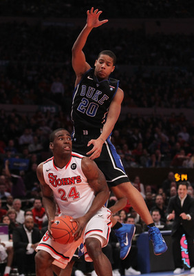 NEW YORK, NY - JANUARY 30: Andre Dawkins #20 of the Duke Blue Devils jumps over the back of Justin Burrell #24 of the St. John's Red Storm at Madison Square Garden on January 30, 2011 in New York City.  (Photo by Nick Laham/Getty Images)