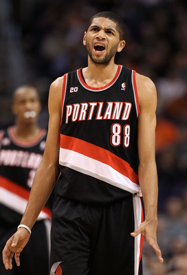 PHOENIX, AZ - JANUARY 14:  Nicolas Batum #88 of the Portland Trail Blazers reacts during the NBA game against the Phoenix Suns at US Airways Center on January 14, 2011 in Phoenix, Arizona.  The Suns defeated the 115-111.  NOTE TO USER: User expressly ackn