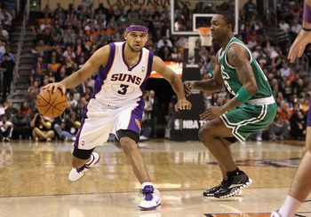 PHOENIX, AZ - JANUARY 28:  Jared Dudley ## of the Phoenix Suns handles the ball under pressure from Von Wafer #12 of the Boston Celtics during the NBA game at US Airways Center on January 28, 2011 in Phoenix, Arizona. The Suns defeated the Celtics 88-71.