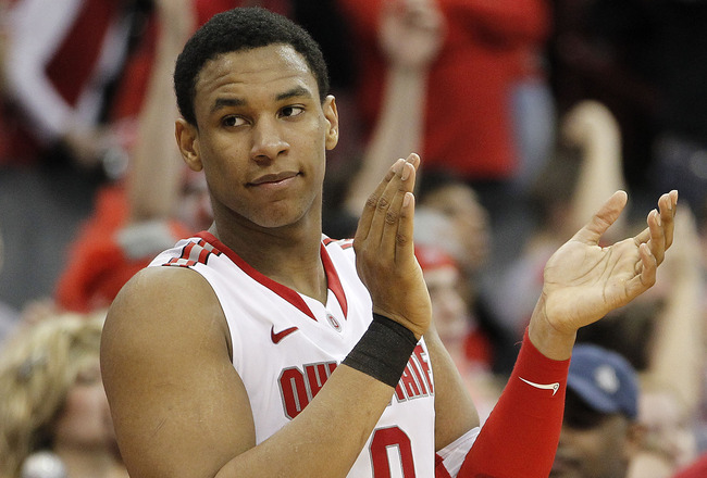 COLUMBUS, OH - FEBRUARY 15:  Jared Sullinger #0 of the Ohio State Buckeyes appluads his teammates as Ohio State defeated the Michigan State Spartans 71-61 on February 15, 2011 at Value City Arena in Columbus, Ohio.  (Photo by Gregory Shamus/Getty Images)