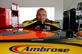 DAYTONA BEACH, FL - FEBRUARY 16:  Marcos Ambrose, driver of the #9 Stanley Ford, stands next to his car in the garage during practice for the NASCAR Sprint Cup Series Daytona 500 at Daytona International Speedway on February 16, 2011 in Daytona Beach, Flo