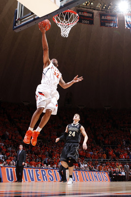 CHAMPAIGN, IL - FEBRUARY 13: Demetri McCamey #32 of the Illinois Fighting Illini lays the ball in on a fast break ahead of Ryne Smith #24 of the Purdue Boilermakers at Assembly Hall on February 13, 2011 in Champaign, Illinois. Purdue defeated Illinois 81-