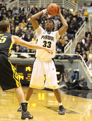 WEST LAFAYETTE, IN - JANUARY 09:  E'Twaun Moore #33 of the Purdue Boilermakerslooks to pass the ball against the Iowa Hawkeyes during the Big Ten Conference game at Mackey Arena on January 9, 2011 in West Lafayette, Indiana. Purdue won 75-52.  (Photo by A