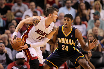 MIAMI, FL - FEBRUARY 08:  Mike Miller #13 of the Miami Heat posts up Paul George #24 of the Indiana Pacers during a game at American Airlines Arena on February 8, 2011 in Miami, Florida. NOTE TO USER: User expressly acknowledges and agrees that, by downlo