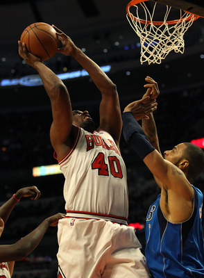 CHICAGO, IL - JANUARY 20: Kurt Thomas #40 of the Chicago Bulls goes up for a shot against Tyson Chandler #6 of the Dallas Mavericks at the United Center on January 20, 2011 in Chicago, Illinois. The Bulls defeated the Mavericks 82-77. NOTE TO USER: User e
